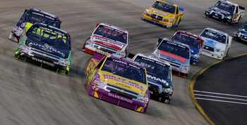 LEBANON, TN - APRIL 22: Elliott Sadler, driver of the #21 Bully Hill Vineyards Chevrolet, leads a pack of trucks during the NASCAR Camping World Truck Series Bully Hill Vineyards 200 at Nashville Superspeedway on April 22, 2011 in Lebanon, Tennessee.  (Ph