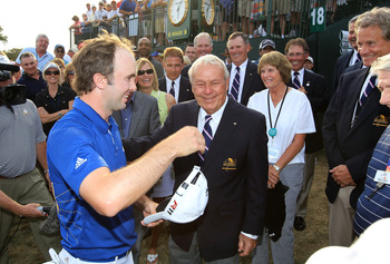 ORLANDO, FL - MARCH 27:  Martin Laird of Scotland is greeted by Arnold Palmer of the USA after he had secured victory on the 18th green during the final round of the 2011 Arnold Palmer Invitational presented by Mastercard at the Bay Hill Lodge and Country