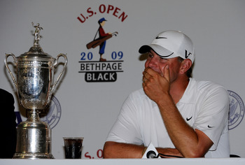 FARMINGDALE, NY - JUNE 22:  Lucas Glover speaks with the media after alongside the winner's trophy after his two-stroke victory at the 109th U.S. Open on the Black Course at Bethpage State Park on June 22, 2009 in Farmingdale, New York.  (Photo by Sam Gre