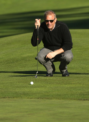PEBBLE BEACH, CA - FEBRUARY 07:  Actor Kevin Costner lines up his putt on the third hole during the first round of the AT&T Pebble Beach National Pro-Am at Poppy Hills Golf Course February 7, 2008  in Pebble Beach, California.  (Photo by Stephen Dunn/Gett