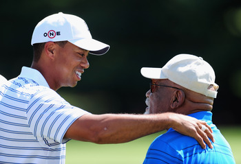 AKRON, OH - AUGUST 05:  Tiger Woods of USA speaks with Charlie Sifford the first African American inducted into the World Golf Hall of Fame during a practice round of the World Golf Championship Bridgestone Invitational on August 5, 2009 at Firestone Coun