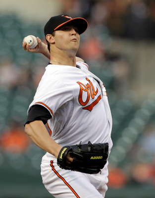 BALTIMORE, MD - APRIL 26: Pitcher Zach Britton #53 of the Baltimore Orioles delivers to a Boston Red Soxbatter during the first inning at Oriole Park at Camden Yards on April 26, 2011 in Baltimore, Maryland.  (Photo by Rob Carr/Getty Images)
