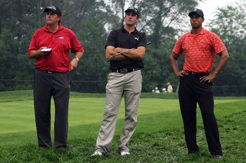 MEDINAH, IL - AUGUST 18:  Phil Mickelson, Geoff Ogilvy and Tiger Woods look on during the second round of the 2006 PGA Championship at Medinah Country Club on August 18, 2006 in Medinah, Illinois.  (Photo by Jeff Gross/Getty Images)