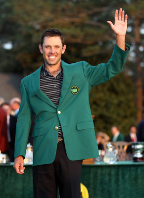 AUGUSTA, GA - APRIL 10:  Charl Schwartzel of South Africa is presented with his Green Jacket after winning the Masters after the final round of the 2011 Masters Tournament at Augusta National Golf Club on April 10, 2011 in Augusta, Georgia.  (Photo by Ros