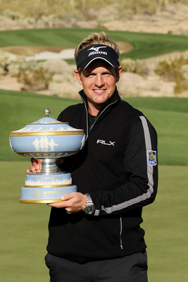MARANA, AZ - FEBRUARY 27:  Luke Donald of England celebrates with The Walter Hagen Cup trophy after winning his match 3-up on the 16th hole during the final round of the Accenture Match Play Championship at the Ritz-Carlton Golf Club on February 27, 2011