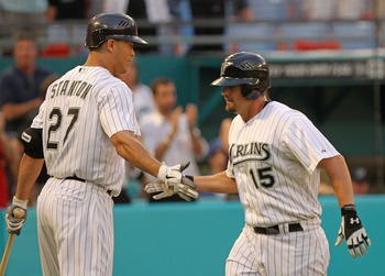 MIAMI GARDENS, FL - APRIL 26:  Gaby Sanchez #15 of the Florida Marlins is congratulated by Mike Stanton #27 after hitting a HR during a game against the Los Angeles Dodgers at Sun Life Stadium on April 26, 2011 in Miami Gardens, Florida.  (Photo by Mike E