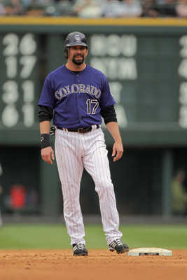 DENVER, CO - APRIL 20:  First baseman Todd Helton #17 of the Colorado Rockies looks on from second base after hitting a double against the San Francisco Giants at Coors Field on April 20, 2011 in Denver, Colorado.  (Photo by Doug Pensinger/Getty Images)