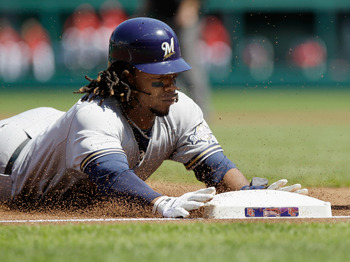 WASHINGTON, DC - APRIL 17:  Rickie Weeks #23 of the Milwaukee Brewers slides safely into third base during the first inning against the Washington Nationals during game one of a doubleheader at Nationals Park on April 17, 2011 in Washington, DC.  (Photo b