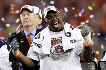 GLENDALE, AZ - JANUARY 10:  Nick Fairley #90 of the Auburn Tigers celebrates the Tigers 22-19 victory against the Oregon Ducks during the Tostitos BCS National Championship Game at University of Phoenix Stadium on January 10, 2011 in Glendale, Arizona.  (