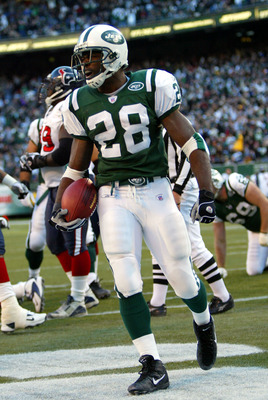 EAST RUTHERFORD, NJ - DECEMBER 5:  Curtis Martin #28 of the New York Jets celebrates his touchdown in the third quarter against the Houston Texans on December 5, 2004 at Giants Stadium in East Rutherford, New Jersey. The Jets defeated the Texans 29-7.  (P