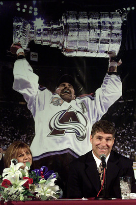 26 Jun 2001:  Veteran defenseman Ray Bourque #77 of the Colorado Avalanche smiles with his wife Christiane at his side after announcing his retirement after playing 22 seasons in the National Hockey League with the Boston Bruins and the Colorado Avalanche