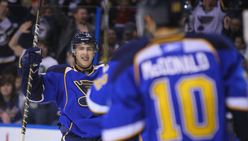 ST. LOUIS, MO - APRIL 5: Kevin Shattenkirk #12 of the St. Louis Blues celebrates his goal against the Colorado Avalanche at the Scottrade Center on April 5, 2011 in St. Louis, Missouri.  (Photo by Dilip Vishwanat/Getty Images)