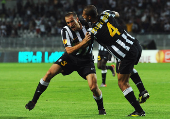 TURIN, ITALY - SEPTEMBER 16:  Giorgio Chiellini (L) of Juventus FC celebrates his goal with Felipe Melo during the Uefa Europa League group A match Juventus FC and KKS Lech Poznan at Olimpico Stadium on September 16, 2010 in Turin, Italy.  (Photo by Valer