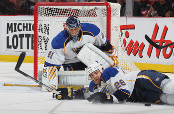 DETROIT, MI - NOVEMBER 17:  Carlo Colaiacovo #28 of the St. Louis Blues blocks a shot in front of teammate Jaroslav Halak #41 in a game against the Detroit Red Wings on November 17,2010 at the Joe Louis Arena in Detroit, Michigan. The Wings defeated the B