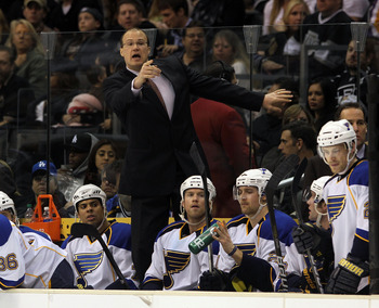 LOS ANGELES, CA - JANUARY 13:  Head coach Davis Payne of the St. Louis Blues handles bench duties against the Los Angeles Kings at the Staples Center on January 13, 2011 in Los Angeles, California.  (Photo by Bruce Bennett/Getty Images)