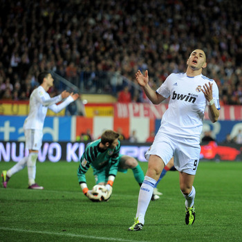 MADRID, SPAIN - MARCH 19: Karim Benzema of Real Madrid reacts after his shot at goal was saved   during the La Liga match between Atletico Madrid and Real Madrid at Vicente Calderon Stadium on March 19, 2011 in Madrid, Spain.  (Photo by Denis Doyle/Getty