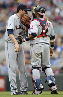 MINNEAPOLIS, MN - APRIL 23: Justin Germano #39 and Carlos Santana #41 of the Cleveland Indians speak during the eighth inning of their game against the Minnesota Twins on April 23, 2011 at Target Field in Minneapolis, Minnesota. Twins defeated the Indians