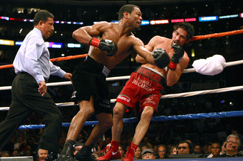 LOS ANGELES - JANUARY 24:   Shane Mosley lands a punch on Antonio Margarito as Margarito's corner throws in the towel en route to a TKO in the ninth round during their WBA welterweight title fight on January 24, 2009 at the Staples Center in Los Angeles,