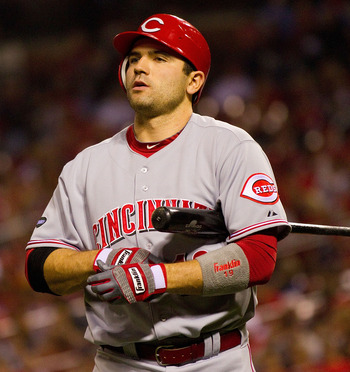 ST. LOUIS, MO - APRIL 22: Joey Votto #19 of the Cincinnati Reds returns to the dugout after striking out against the St. Louis Cardinals at Busch Stadium on April 22, 2011 in St. Louis, Missouri.  (Photo by Dilip Vishwanat/Getty Images)