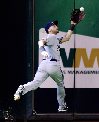 HOUSTON - SEPTEMBER 15:  Left fielder Ryan Braun #8 of the Milwaukee Brewers makes a running catch on a ball hit by Angel Sanchez of the Houston Astros in the ninth inning at Minute Maid Park on September 15, 2010 in Houston, Texas.  (Photo by Bob Levey/G