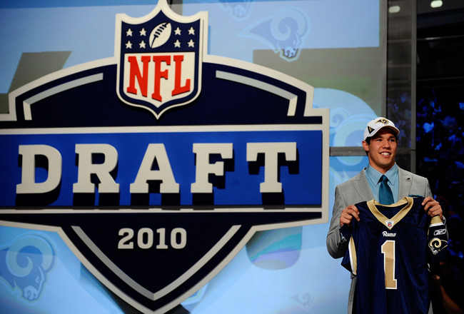 NEW YORK - APRIL 22:  Quarterback Sam Bradford of the Oklahoma Soomers holds up a St. Louis Rams jersey after he was picked numer 1 overall by the Rams during the 2010 NFL Draft at Radio City Music Hall on April 22, 2010 in New York City.  (Photo by Jeff