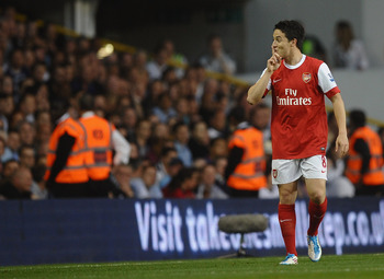 LONDON, ENGLAND - APRIL 20:  Samir Nasri of Arsenal gestures to the Spurs fans after scoring their second goal during the Barclays Premier League match between Tottenham Hotspur and Arsenal at White Hart Lane on April 20, 2011 in London, England.  (Photo