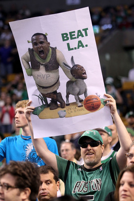 BOSTON - JUNE 13:  A fan of the Boston Celtics holds up a sign in reference to a Shrek and Donkey comment made by Glen Davis #11 and Nate Robinson #4 against the Los Angeles Lakers during Game Five of the 2010 NBA Finals on June 13, 2010 at TD Garden in B