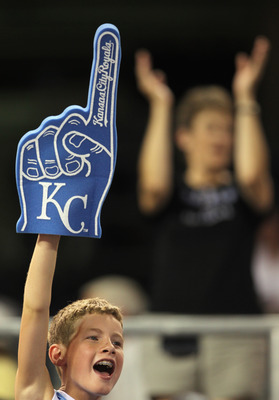 KANSAS CITY, MO - JULY 19:  A young fan cheers during the 10th inning of the game between the Toronto Blue Jays and the Kansas City Royals on July 19, 2010 at Kauffman Stadium in Kansas City, Missouri. The Royals defeated the Blue Jays 5-4.  (Photo by Jam