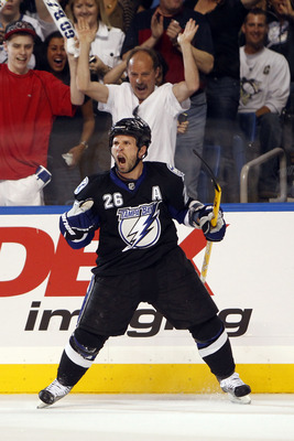 TAMPA, FL - APRIL 20: Martin St. Louis #26 of the Tampa Bay Lightning celebrates a goal against the Pittsburgh Penguins in Game Four of the Eastern Conference Quarterfinals during the 2011 NHL Stanley Cup Playoffs at the St. Pete Times Forum on April 20,