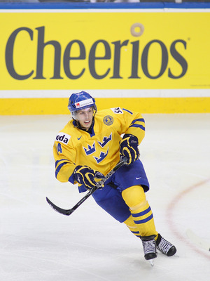 BUFFALO, NY - JANUARY 03:  Max Friberg #14 of Sweden skates against Russia during the 2011 IIHF World U20 Championship Semi Final game between Sweden and Russia on January 3, 2011 in Buffalo, New York. Russia won 4-3 and faces Canada in the gold medal gam