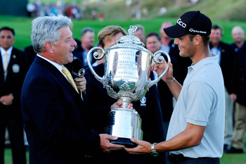 KOHLER, WI - AUGUST 15:  PGA of America President Jim Remy (L) presents the Wanamaker Trophy to Martin Kaymer of Germany at the 92nd PGA Championship on the Straits Course at Whistling Straits on August 15, 2010 in Kohler, Wisconsin.  (Photo by Stuart Fra