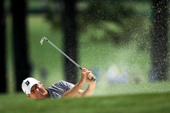 AUGUSTA, GA - APRIL 10:  Fred Couples his a bunker shot on the first hole during the final round of the 2011 Masters Tournament on April 10, 2011 in Augusta, Georgia.  (Photo by Jamie Squire/Getty Images)