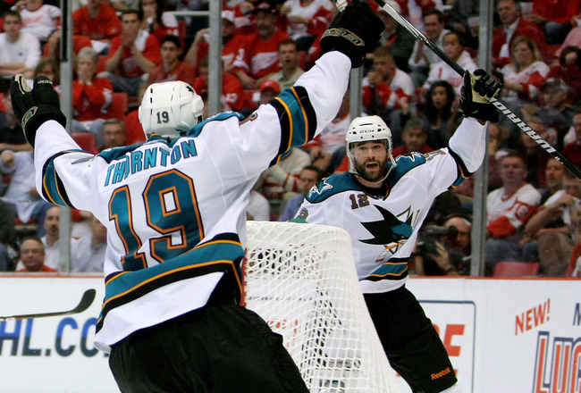 DETROIT - MAY 4:  Patrick Marleau #12 of the San Jose Sharks celebrates his overtime game-winning goal with teammate Joe Thornton #19 who assisted on the goal against the Detroit Red Wings in Game Three of the Western Conference Semifinals during the 2010