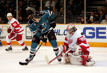 SAN JOSE, CA - JANUARY 09: Jimmy Howard #35 of the Detroit Red Wings makes a save on a shot taken by Joe Pavelski #8 of the San Jose Sharks at HP Pavilion on January 9, 2010 in San Jose, California. (Photo by Ezra Shaw/Getty Images)
