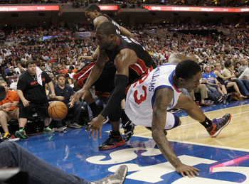 PHILADELPHIA, PA - APRIL 24:  Mario Chalmers #15 (L) and Dwyane Wade #3 of the Miami Heat (C) go after a loose ball with Lou Williams #23 of the Philadelphia 76ers during the second half in Game Four of the Eastern Conference Quarterfinals in the 2011 NBA