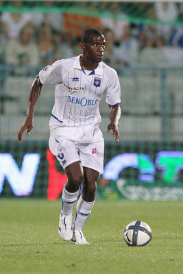 AUXERRE, FRANCE - AUGUST 07:  Adama  Coulibaly of Auxerre in action during the Ligue 1 match between Auxerre and Lorient at Abbe-Deschamp Stadium on August 7, 2010 in Auxerre, France.  (Photo by Julien M. Hekimian/Getty Images)