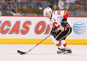 GLENDALE, AZ - MARCH 10:  Jarome Iginla #12 of the Calgary Flames skates with the puck during the NHL game against the Phoenix Coyotes at Jobing.com Arena on March 10, 2011 in Glendale, Arizona.  The Coyotes defeated the Flames 3-0.  (Photo by Christian P