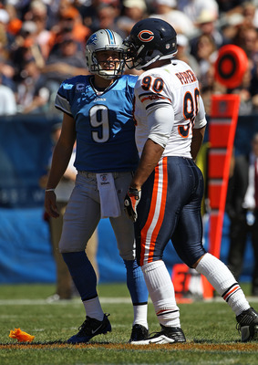 CHICAGO - SEPTEMBER 12: Julius Peppers #90 of the Chicago Bears talks with Matthew Stafford #9 of the Detroit Lions after a late hit in the head earning a penalty for Peppers during the NFL season opening game at Soldier Field on September 12, 2010 in Chi