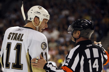 TAMPA, FL - APRIL 18: Jordan Staal #11 of the Pittsburgh Penguins chats with NHL Referee Dennis LaRue #14 during a break in the action against the Tampa Bay Lightning in Game Three of the Eastern Conference Quarterfinals during the 2011 NHL Stanley Cup Pl
