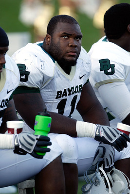 COLUMBIA, MO - NOVEMBER 07:  Defensive tackle Phil Taylor #11 of the Baylor Bears watches from the bench during the game against the Missouri Tigers at Faurot Field at Memorial Stadium on November 7, 2009 in Columbia, Missouri.  (Photo by Jamie Squire/Get