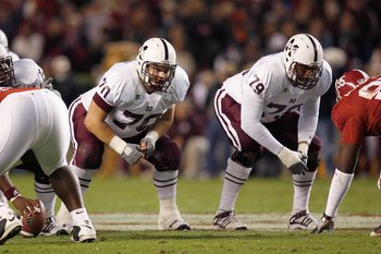TUSCALOOSA, AL - NOVEMBER 15:  J.C. Brignone #70 and Derek Sherrod #79of the Mississippi State Bulldogs get ready on the line of scrimmage during the game against the Alabama Crimson Tide at Bryant-Denny Stadium on November 15, 2008 in Tuscaloosa, Alabama
