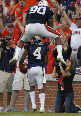 AUBURN - OCTOBER 16:  Defensive lineman Nick Fairley #90 of the Auburn Tigers jumps on the back of teammate and safety Zac Etheridge #4 after Etheridge's fumble return for a touchdown during the game against the Arkansas Razorbacks at Jordan-Hare Stadium