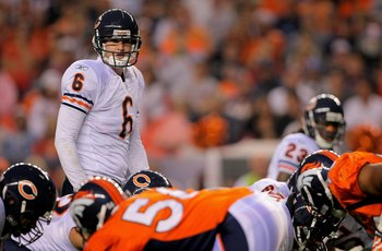 DENVER - AUGUST 30:  Quarterback Jay Cutler #6 of the Chicago Bears runs the offense against the Denver Broncos during preseason NFL action at INVESCO Field at Mile High on August 30, 2009 in Denver, Colorado. The Bears defeated the Broncos 27-17.  (Photo