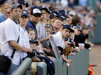 BALTIMORE, MD - APRIL 23:  New York Yankees fans try and get autographs prior to the start of the New York Yankees and Baltimore Orioles game at Oriole Park at Camden Yards on April 23, 2011 in Baltimore, Maryland.  (Photo by Rob Carr/Getty Images)