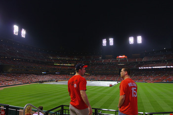 ST. LOUIS, MO - APRIL 19: Fans wait out a rain delay as a severe thunder storm moves in prior to the Washington Nationals playing the St. Louis Cardinals at Busch Stadium on April 19, 2011 in St. Louis, Missouri.  (Photo by Dilip Vishwanat/Getty Images)