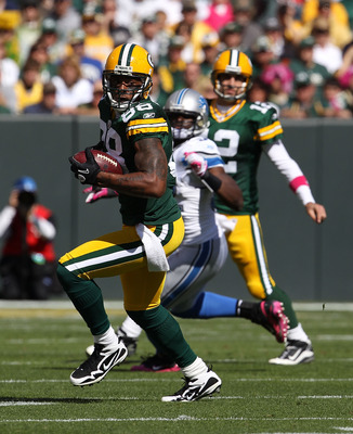 GREEN BAY, WI - OCTOBER 03: Jermichael Finley #88 of the Green Bay Packers runs with the ball after making a catch from Aaron Rodgers #12 against the Detroit Lions at Lambeau Field on October 3, 2010 in Green Bay, Wisconsin. The Packers defeated the Lions