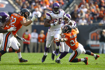 CHICAGO - OCTOBER 19:  Adrian Peterson #28 of the Minnesota Vikings runs for a 54-yard touchdown in the third quarter against the Chicago Bears at Soldier Field on October 19, 2008 in Chicago, Illinois.  (Photo by Jeff Gross/Getty Images)