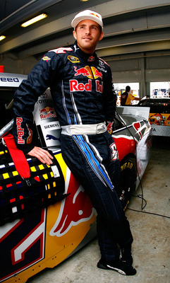 HOMESTEAD, FL - NOVEMBER 20:  Scott Speed, driver of the #82 Red Bull Toyota, stands in the garage during practice for the NASCAR Sprint Cup Series Ford 400 at Homestead-Miami Speedway on November 20, 2010 in Homestead, Florida.  (Photo by Jason Smith/Get