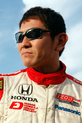 MOTEGI, JAPAN - SEPTEMBER 18:  Hideki Mutoh of Japan, driver of the #06 Formula Dream/Panasonic Dallara Honda talks with the media after qualifying for the IndyCar Series Indy Japan 300 on September 18, 2010 in Motegi, Japan.  (Photo by Chris Graythen/Get