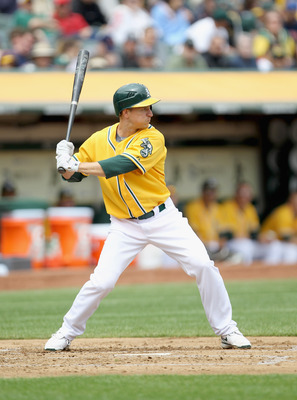 OAKLAND, CA - APRIL 20:  Mark Ellis #14 of the Oakland Athletics in action against the Boston Red Sox at Oakland-Alameda County Coliseum on April 20, 2011 in Oakland, California.  (Photo by Ezra Shaw/Getty Images)